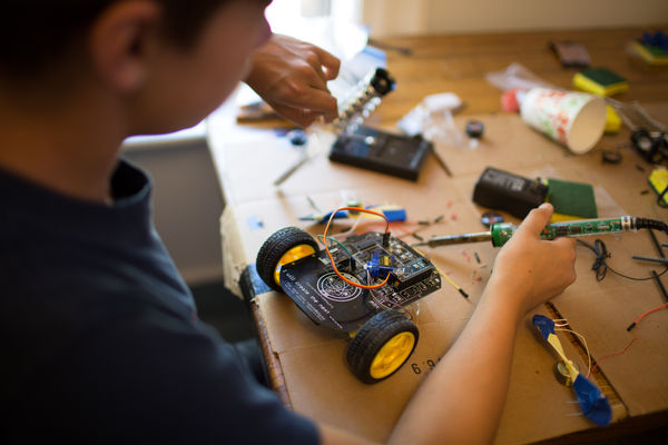 Child working on a robotics project